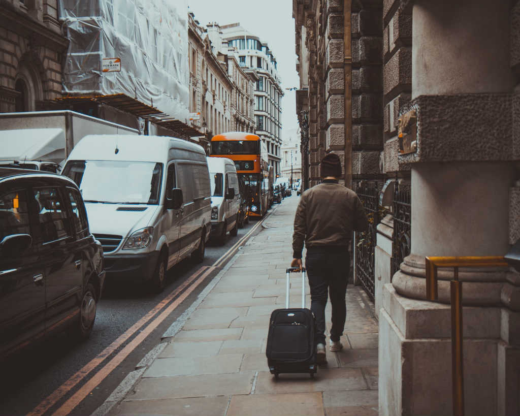 man with suitcase walking on road in a big city, Magic of London - Part 1, Why I love London by Miss F Mixer